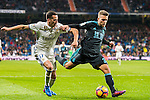 Lucas Vazquez (l) of Real Madrid battles for the ball with Kevin Rodrigues of Real Sociedad during their La Liga match between Real Madrid and Real Sociedad at the Santiago Bernabeu Stadium on 29 January 2017 in Madrid, Spain. Photo by Diego Gonzalez Souto / Power Sport Images
