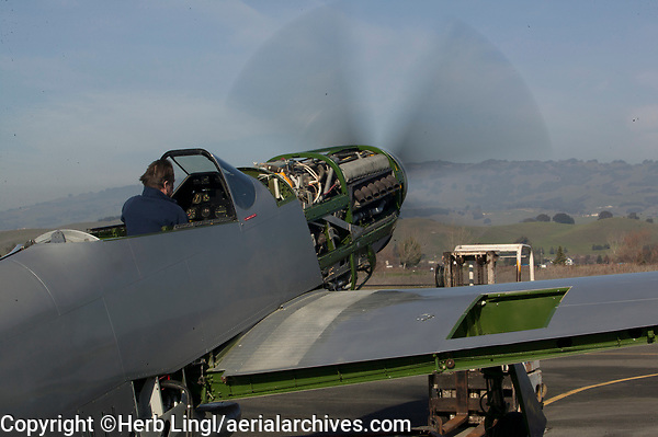 George Perez runs test the engine on his restoration of a North American P-51 Mustang at the Petaluma Municipal Airport, Petaluma, Sonoma County, California.