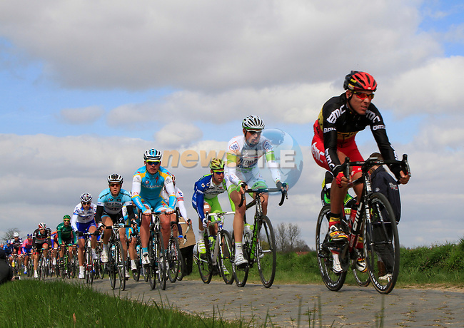 The peloton including BMC Racing Team's Philippe Gilbert (BEL) on the 2nd cobbled sector at Doorne during the 96th edition of The Tour of Flanders 2012, running 256.9km from Bruges to Oudenaarde, Belgium. 1st April 2012. <br /> (Photo by Steven Franzoni/NEWSFILE).