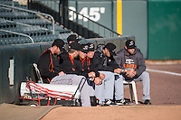 Members of the Sacramento River Cats pitching staff sit in the bullpen before the game against the Salt Lake Bees in Pacific Coast League action at Smith's Ballpark on April 20, 2015 in Salt Lake City, Utah.  (Stephen Smith/Four Seam Images)