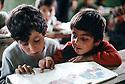 Irak 1992    Ecoliers pendant un cours de lecture à Halabja  <br /> Iraq 1992 In a school of Halabja, pupils in a reading class