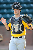 Catcher Chris Harvey (39) of the Bristol Pirates warms up before a game against the Greeneville Astros on Friday, July 25, 2014, at Pioneer Park in Greeneville, Tennessee. Greeneville won, 9-4. (Tom Priddy/Four Seam Images)