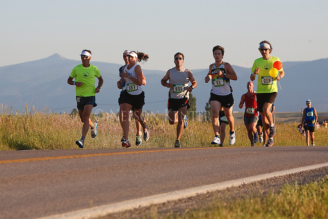 runners participating in the missoula marathon on the course in missoula, montana