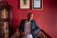 Anele Dyasi, 23, photographed at the Cape Town College of Magic. Dyasi, who comes from one of Cape Town's poorest townships, says his life has been transformed by magic. Once a student at the school, he is now a teacher.