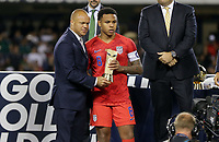 CHICAGO, ILLINOIS - JULY 07: Earnie Stewart awards Weston McKennie #8 his trophy during the 2019 CONCACAF Gold Cup Final match between the United States and Mexico at Soldier Field on July 07, 2019 in Chicago, Illinois.