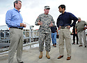 From left to right,  U.S. Senator David Vitter,  Army Corps of Engineers Colonel Ed Fleming and Louisiana Bobby Jindal tour the new levee wall and pumps at the 17th Street Canal, built after Hurricane Katrina,  as Hurricane Isaac approaches New Orleans, Tuesday, Aug. 28, 2012. The Category 1 hurricane is expected to hit New Orleans overnight....(AP Photo/Cheryl Gerber)