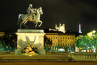 Lyon, France, Rhone-Alpes, Europe, Louis XIV statue illuminated at night in Place Bellecour in downtown Lyon.