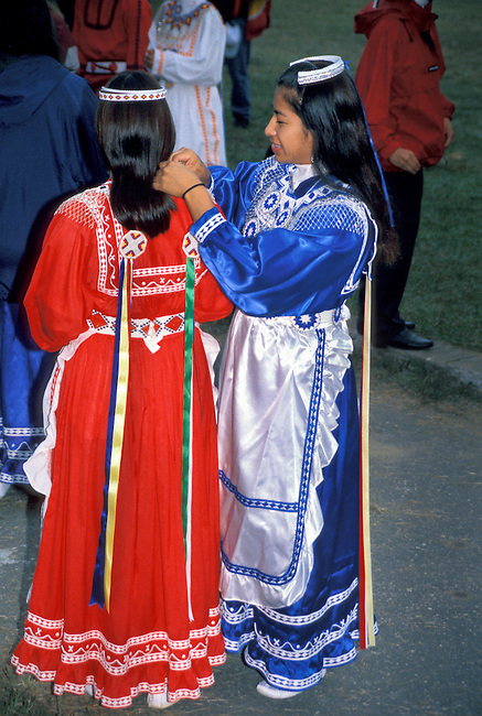 Young Chickasaw lady dancers dressed in traditional clothing attend to last minute touches