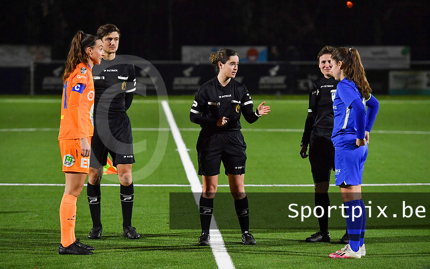 Silke Vanwynsberghe (21) of AA Gent pictured with referee Irmgard Van Meirvenne , assistant Gianni Seeldraeyers , assistant Ella De Vries and midfielder Sien Vandersanden (10) of KRC Genk during a female soccer game between  Racing Genk Ladies and AA Gent Ladies on the eleventh matchday of the 2020 - 2021 season of Belgian Scooore Womens Super League , friday 22 th of January 2021  in Genk , Belgium . PHOTO SPORTPIX.BE | SPP | DAVID CATRY