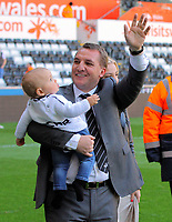 FAO SPORTS PICTURE DESK<br /> Pictured: Manager Brendan Rodgers with his grandson thanking Swansea supporters at the end of the game. Sunday, 13 May 2012<br /> Re: Premier League football, Swansea City FC v Liverpool FC at the Liberty Stadium, south Wales.