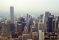 "Chicago: Panorama from Hancock looking south. Note the ""tiny"" Carbide and Carbon Building, center. Compare height and mass to Amoco Tower, left. Just  peaking out is the Wrigley Building. Photo '88."