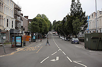Pictured: The empty Walter Road in Swansea, which is usually busy with traffic during rush hour Wednesday 06 July 2016<br />Re: Empty street in central Swansea, during rush hour, before the UEFA Euro 2016 Portugal v Wales semi-final