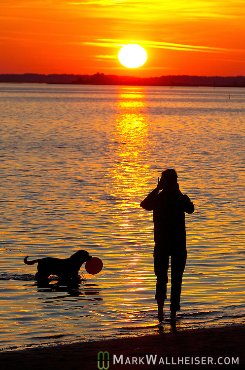 Scott Bunkley and his dog Bane enjoy the Thanksgiving day sunset at Shell Point Beach in Wakulla County, Florida November 22, 2012.