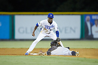 Burlington Royals shortstop Maikel Garcia (2) applies a tag to Gustavo Campero (24) of the Pulaski Yankees as he slides head first into second base at Burlington Athletic Stadium on August 25, 2019 in Burlington, North Carolina. The Yankees defeated the Royals 3-0. (Brian Westerholt/Four Seam Images)