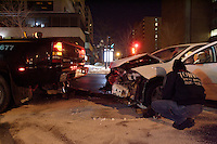 Montreal QC CANADA - file photo - Car accident at night in Montreal downtown's Rene-Levesque and Saint-Urbain