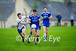 Annascaul's James Crean on a solo run as Donal O'Neill of Keel keeps track off him, in the Junior Premier football championship