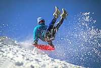 Action image of a sledder in midair.