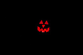 Schenectady, NY. Smiling jack-o-lantern face carved from pumpkin in a dark room. ID: AK-ICP. © Ellen B. Senisi