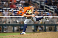 Auburn Tigers pitcher Tanner Burns (32) follows through on his delivery during Game 4 of the NCAA College World Series against the Mississippi State Bulldogs on June 16, 2019 at TD Ameritrade Park in Omaha, Nebraska. Mississippi State defeated Auburn 5-4. (Andrew Woolley/Four Seam Images)