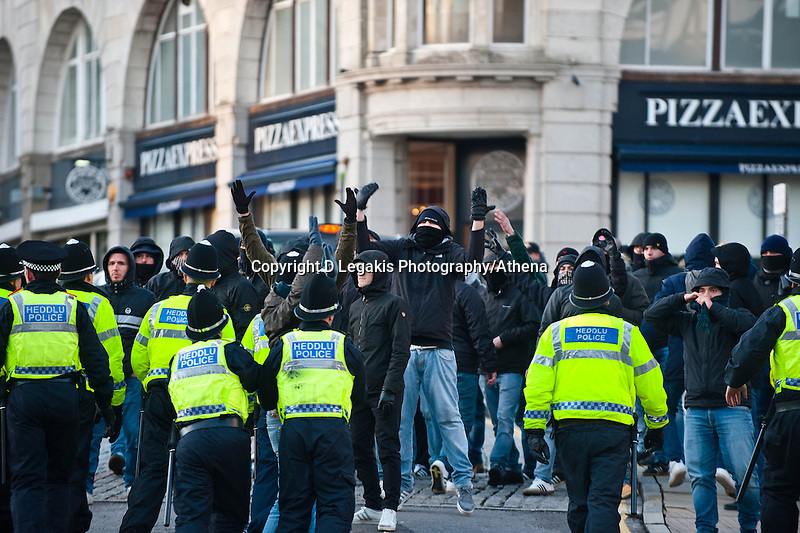 Thursday 20 February 2014<br /> Pictured: Napoli fans and Swansea city fans are sepereated by police on the top of Swansea's busy Wind Street<br /> Re: Napoli Supporters visit Swansea for tonights UEFA Leauge clash