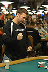 Shawn Chaconas reacts to the turn and the river cards, first dispair, then fist pump.