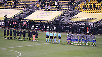 COLUMBUS, OH - DECEMBER 12: The match officials and starters for both teams line up during the playing of the national anthem before a game between Seattle Sounders FC and Columbus Crew at MAPFRE Stadium on December 12, 2020 in Columbus, Ohio.