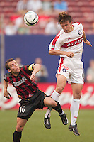 Kelly Grey of the Fire gets off a header despite the best efforts of Richie Williams of the MetroStars. The Chicago Fire defeated the NY/NJ MetroStars 3-2 on 6/14/03 at Giant's Stadium, NJ..
