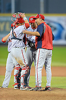 Harrisburg Senators pitching coach Paul Menhart #10 talks with pitcher Neil Holland #25 and catcher Sandy Leon #40 during a game against the Erie Seawolves on July 2, 2013 at Jerry Uht Park in Erie, Pennsylvania.  Erie defeated Harrisburg 2-1.  (Mike Janes/Four Seam Images)