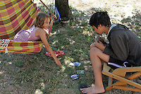 Children playing card game in the garden (Licence this image exclusively with Getty: http://www.gettyimages.com/detail/92866129 )