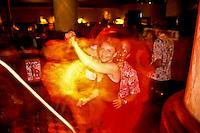 Woman in red dress, swing dancing at a nightclub in the Ala Moana Hotel, Waikiki, Oahu, Hawaii
