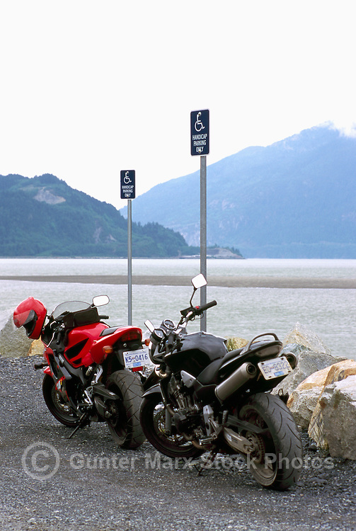 Two Motorcycles traveling together and illegally parked in a Handicap Parking Space, at a West Coast Viewpoint near Squamish, BC, British Columbia, Canada