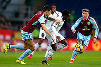 Nathan Dyer of Swansea City is tackled by Jack Cork of Burnley during the Premier League match between Burnley and Swansea City at Turf Moor, Burnley, England, UK. Saturday 18 November 2017