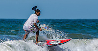 Sports Photograph of a surfer riding the waves in Sayulita Mexico.