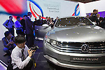 """December 30, 2011, Tokyo, Japan - Press members look at Volkswagen's """"Cross Coupe"""" vehicle during the 42nd Tokyo Motor Show. The show opens to the general public from December 3-11. (Photo by Christopher Jue/AFLO)"""