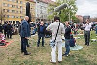 """Auf und rund um den Rosa-Luxemburg-Platz in Berlin-Mitte haben am Samstag den 25. April 2020 mehrere hundert Menschen gegen die Einschraenkungen im Zuge der Massnahmen zur Eindaeemung der Covid-19-Pandemie protestiert. Rechtsextremisten, Hooligans, Antisemiten, Verschwoerungstheoretiker und AfD-Politiker hatten zu einer sogenannten """"Hygiene-Demo"""" versammelt. Vereinzelt protestierten Menschen am Rande gegen diese Demonstration.<br /> Die Polizei war mit mehreren hundert Beamten im Einsatz und nahm mehr als 100 Personen fest.<br /> Im Bild: Das AfD-Mitglied des brandenburgischen Landtag, Lars Guenther (links) wird interviewt.<br /> 25.4.2020, Berlin<br /> Copyright: Christian-Ditsch.de<br /> [NUR FUER REDAKTIONELLE ZWECKE! Werbung nur auf Anfrage beim Fotografen. Inhaltsveraendernde Manipulation des Fotos nur nach ausdruecklicher Genehmigung des Fotografen. Vereinbarungen ueber Abtretung von Persoenlichkeitsrechten/Model Release der abgebildeten Person/Personen liegen nicht vor. NO MODEL RELEASE! Don't publish without copyright Christian-Ditsch.de, Veroeffentlichung nur mit Fotografennennung, sowie gegen Honorar, MwSt. und Beleg. Konto: I N G - D i B a, IBAN DE58500105175400192269, BIC INGDDEFFXXX, Kontakt: post@christian-ditsch.de<br /> Bei der Bearbeitung der Dateiinformationen darf die Urheberkennzeichnung in den EXIF- und  IPTC-Daten nicht entfernt werden, diese sind in digitalen Medien nach §95c UrhG rechtlich geschuetzt. Der Urhebervermerk wird gemaess §13 UrhG verlangt.]"""