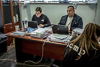 Diana Sarzinski (left) at work at a mortuary facility in Visoko where the International Commission on Missing Persons (ICMP) are working to identify the remains of unidentified victims of the Bosnian war.