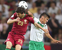 Helder Postiga (23) of Portugal and Carlos Salcido (3) of Mexico go for a high ball. Portugal defeated Mexico 2-1 in their FIFA World Cup Group D match at FIFA World Cup Stadium, Gelsenkirchen, Germany, June 21, 2006.