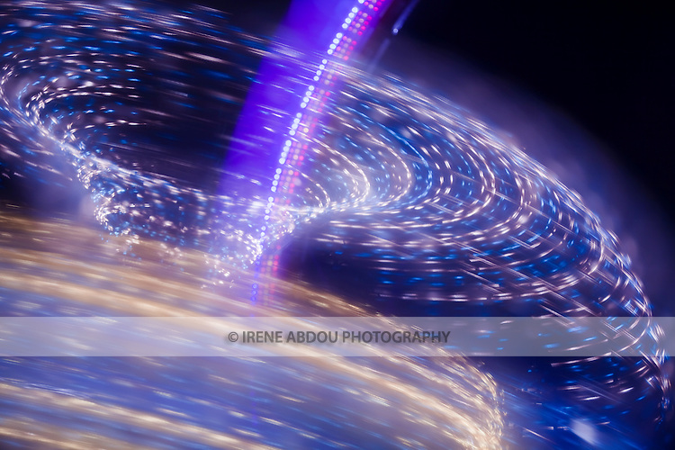 """A photography technique called """"focus blur"""" is used to transform the lights of a spinning carnival ride into abstract designs at the Montgomery County Agricultural Fair in Gaithersburg, Maryland."""