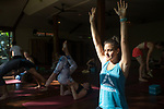 6 DECEMBER, 2019 BALI, INDONESIA: Lea Lock (23) loosens up for a class at The Yoga Barn in Ubud, Bali. There has been a levelling out of Australian tourist numbers to Bali in recent times and tastes are changing regarding what people want from their holiday. Millennials are being targeted by tourism authorities and they want to give them more boutique experiences than just beach and beer. Picture by Graham Crouch/The Australian