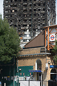Latimer Road tube station and burnt-out shell of Grenfell Tower, Kensington & Chelsea, London.