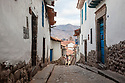 Cusco, showing typical narrow cobbled streets. 3399 metres altitude. Peru.