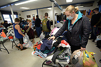 Holly Timmons of Fayetteville sorts through clothes Saturday, Nov. 14, 2020, while shopping at the Country Store at West Fork Community Church. The church hosts a free clothing giveaway and sells breakfast and other food items on the second Saturday of the month to raise money for its women's and children's outreach. Visit nwaonline.com/201115Daily/ for today's photo gallery. <br /> (NWA Democrat-Gazette/Andy Shupe)