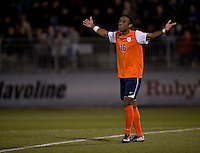 Marcus Salandy-Defour (16) of Virginia celebrates after converting the winning penalty kick at the ACC tournament semifinals at the Maryland SoccerPlex in Boyds, MD.  Virginia advanced to the finals after tying Notre Dame, 3-3, in overtime and then defeating them on penalty kicks.