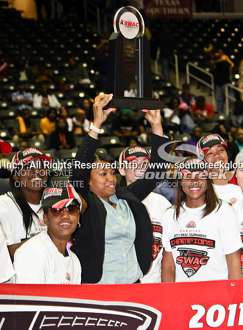 The Prairie View A&M Lady Panthers head coach Toyelle Wilson and her team, hold up the championship trophy after winning the SWAC Tournament Championship game between the Prairie View A&M Lady Panthers and the Southern University Jaguars at the Special Events Center in Garland, Texas. Prairie View defeats  Southern 48 to 44