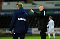 Pictured: Cameron Toshack Coach of Swansea City shouts instructions to his team from the dug-out during the Premier League 2 match between Swansea City and West Ham United at the Liberty Stadium, Swansea, Wales, UK <br /> Monday 11 March 2019