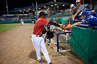 Batavia Muckdogs Ronal Reynoso (2) high fives young fans after a NY-Penn League game against the Lowell Spinners on July 11, 2019 at Dwyer Stadium in Batavia, New York.  Batavia defeated Lowell 5-2.  (Mike Janes/Four Seam Images)