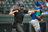 Home plate umpire Thomas Fornarola calls a strike during a game between the Lexington Legends and the Greenville Drive on Sunday, September 2, 2018, at Fluor Field at the West End in Greenville, South Carolina. Greenville won, 7-4. (Tom Priddy/Four Seam Images)