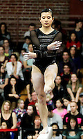 STANFORD, CA--March 1, 2013--Ivana Hong with Stanford women's Gymnastics team competes on the bars during the competition against Cal and Oregon State University on the Stanford University Campus. Stanford won the competition .  Ivana Hong