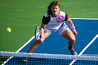 WASHINGTON, DC - AUGUST 1: J.J. Wolf (USA) makes a play at the net against Elias Ymer (SWE) during Qualifying at the 2021 Citi Open at Rock Creek Park Tennis Center on August 1, 2021 in Washington, DC.