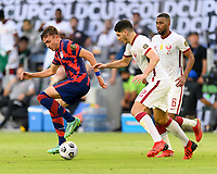 AUSTIN, TX - JULY 29: Sam Vines #3 of the United States rolls the ball back keeping it away from Abdelaziz Hatim #6 and Karim Boudiaf #12 of Qatar during a game between Qatar and USMNT at Q2 Stadium on July 29, 2021 in Austin, Texas.